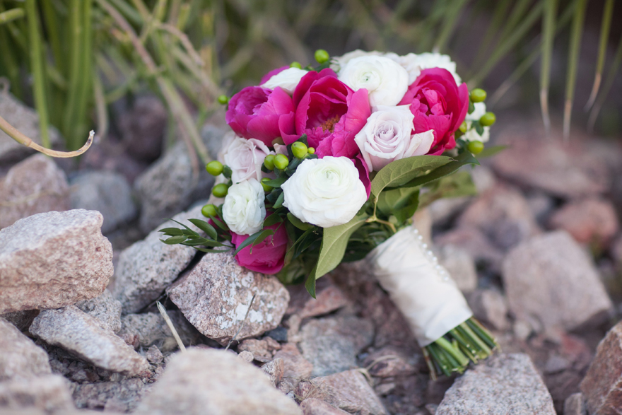 Pale roses and fuchsia peonies make a vibrant bridal bouquet