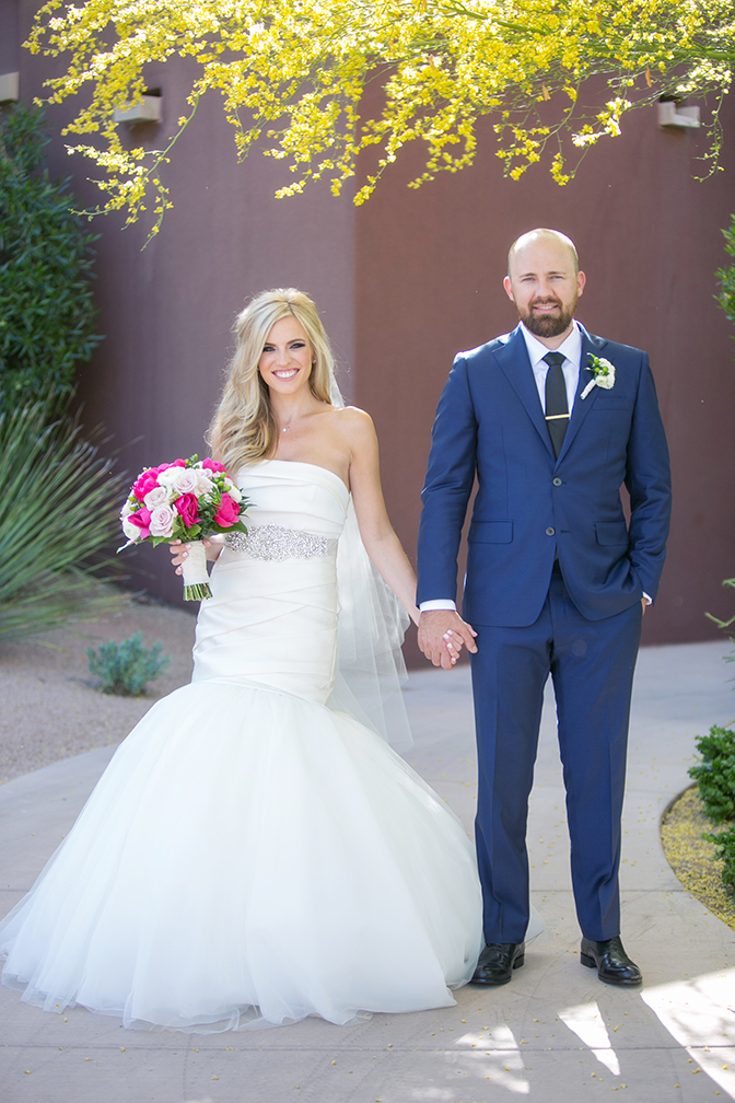 Dazzling blonde bride and her handsome groom in blue