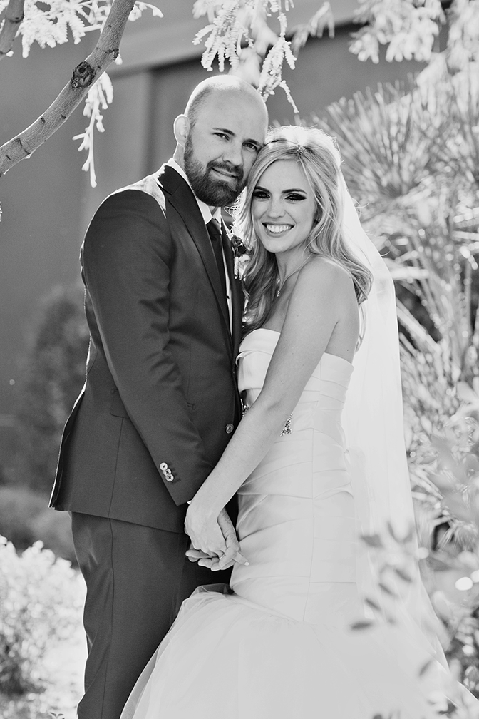 Dazzling blonde bride and her handsome groom smile on their wedding day