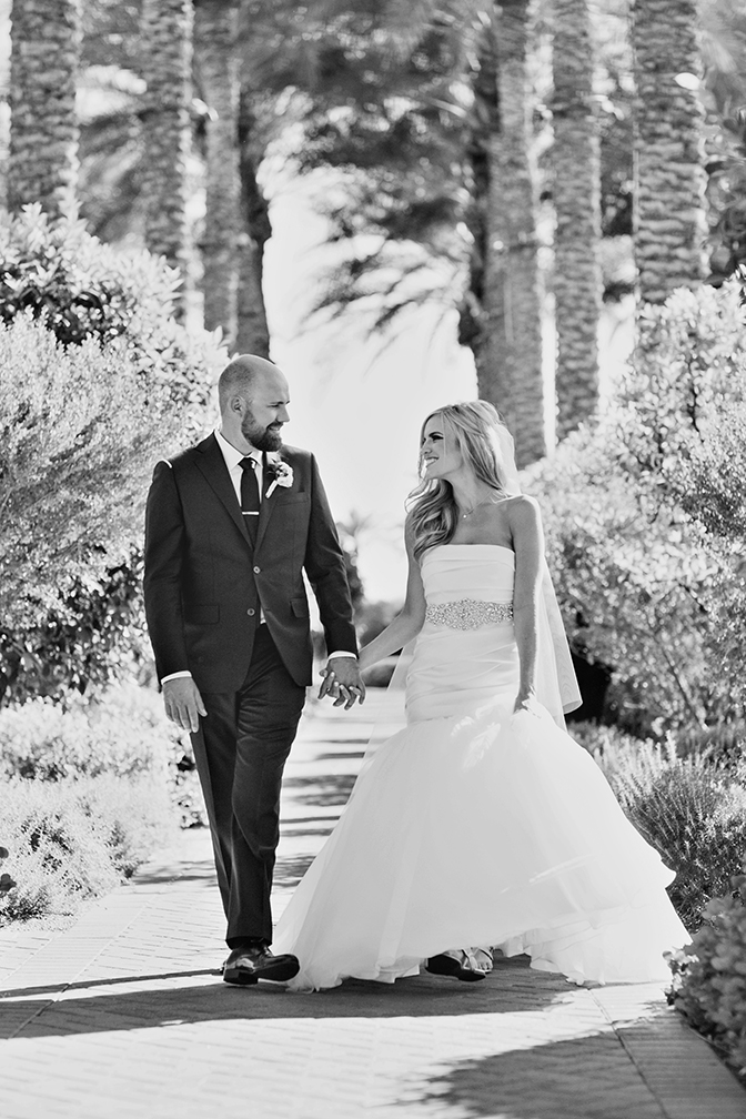 Happy bride & groom, walking hand in hand on their wedding day