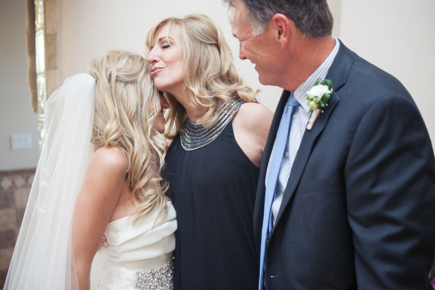 Parents of the bride spend a moment with their daughter before she walks down the aisle