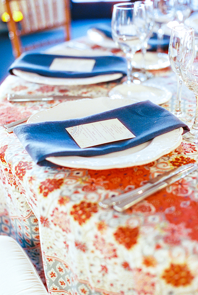 Colorful printed tablecloth with rustic white china