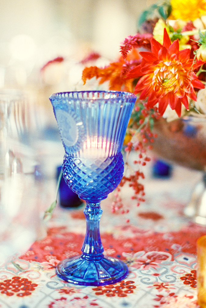 Vivid blue pressed glass and colorful table linens