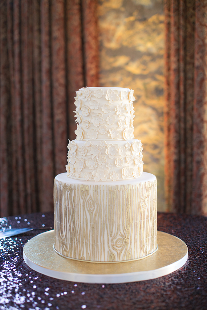Wedding cake decorated with wood gran and dimensional flowers