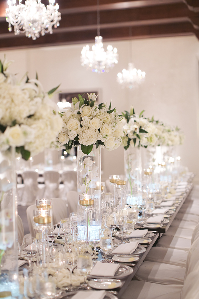 Sparkling reception table with white flowers
