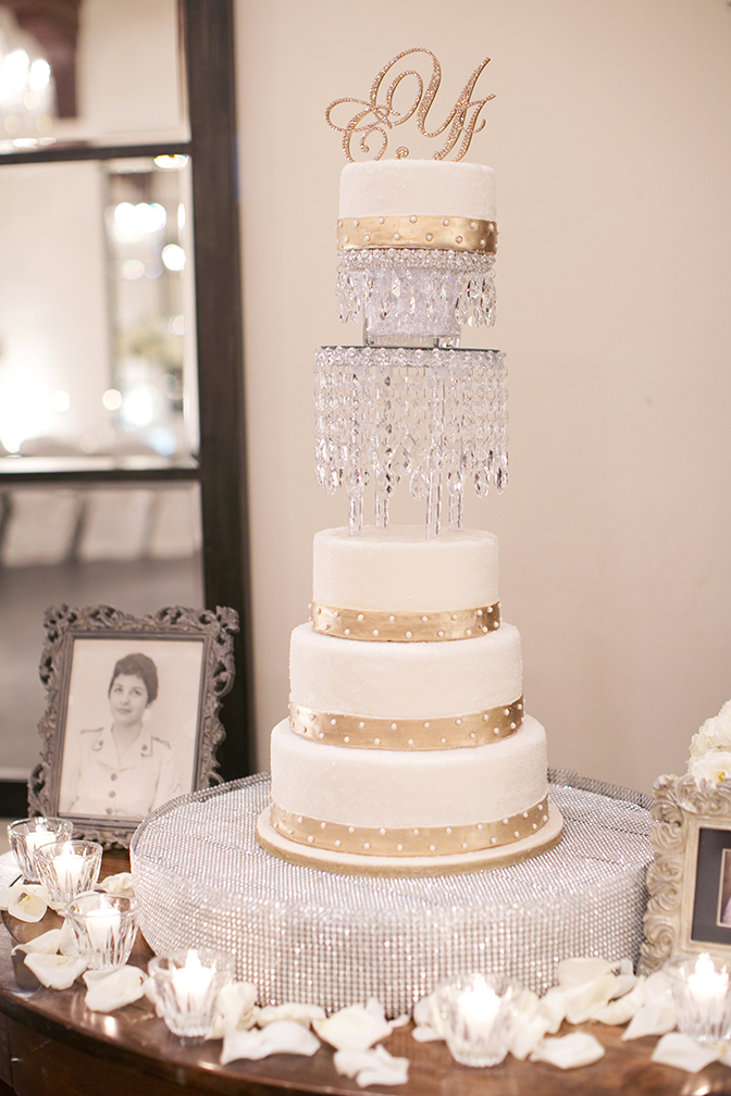 Elegant white wedding cake decorated with crystal and gold