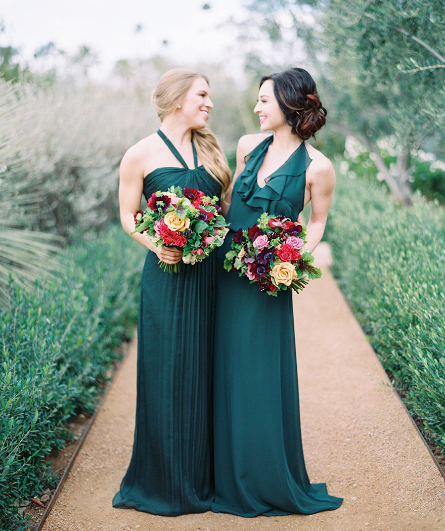 emerald Amsale bridesmaids' dresses with bouquets in yellow & burgundy