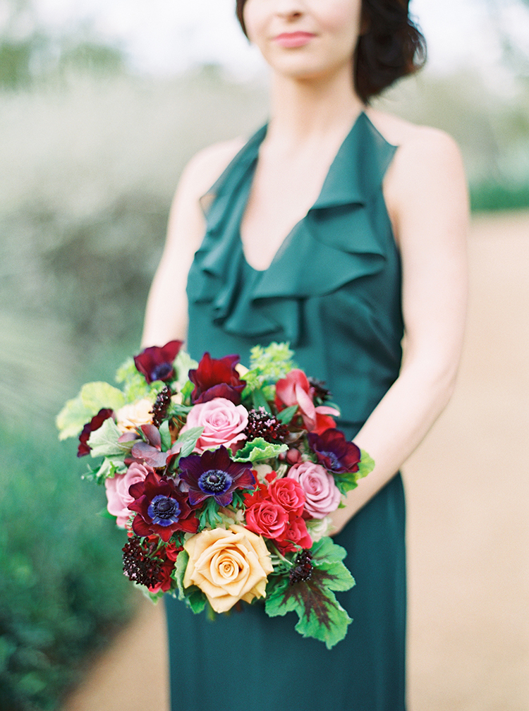 emerald Amsale bridesmaid dress with bouquets in yellow & burgundy