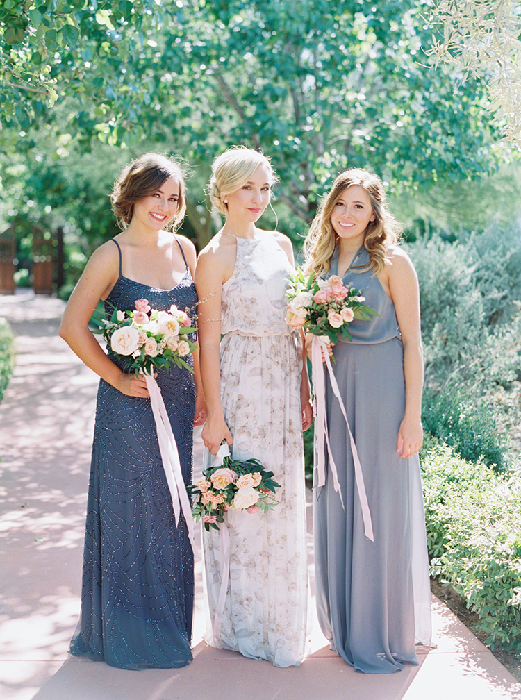 mix-and-match bridesmaids in blue & gray with coral bouquets