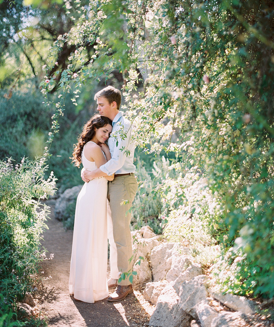 couple embracing at Boyce Thompson Arboretum, outdoor engagement session