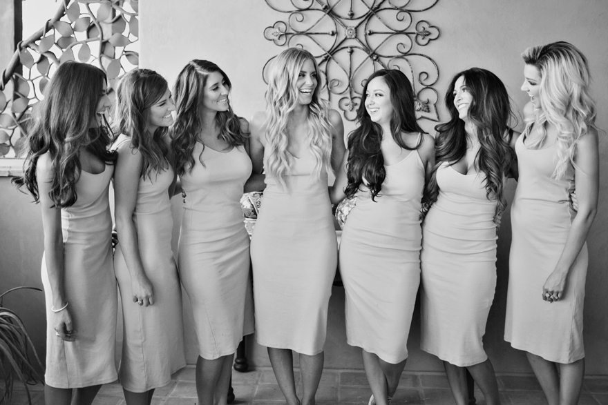 Bride & her bridesmaids laugh together before getting dressed for the wedding