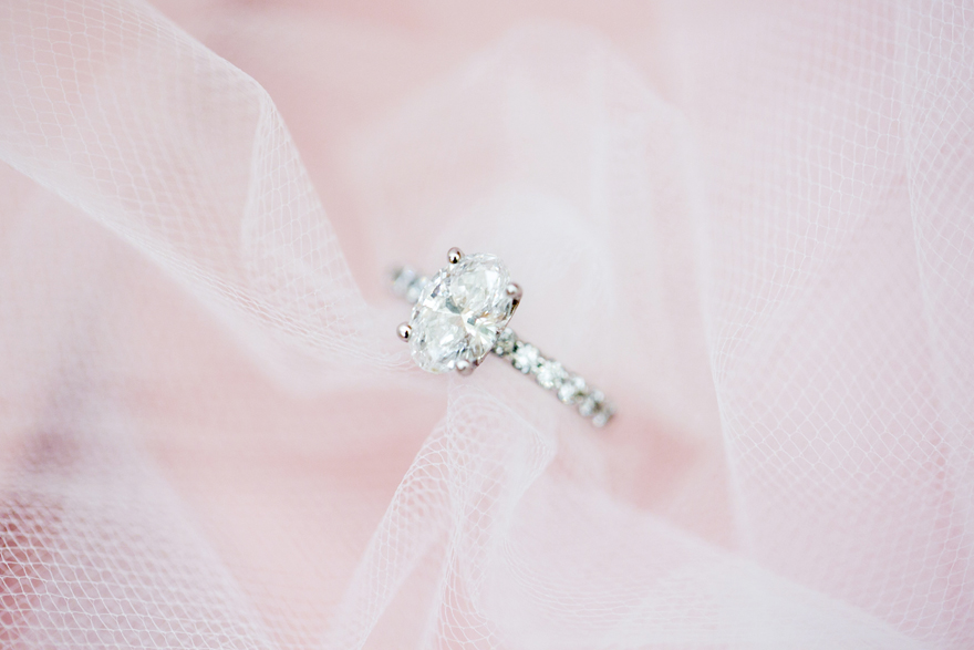 Delicate oval diamond engagement ring