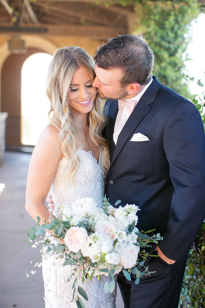 Groom kisses his bride sweetly