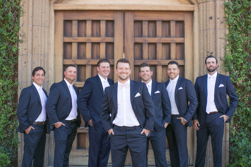 Groomsmen in navy blue with pale pink ties