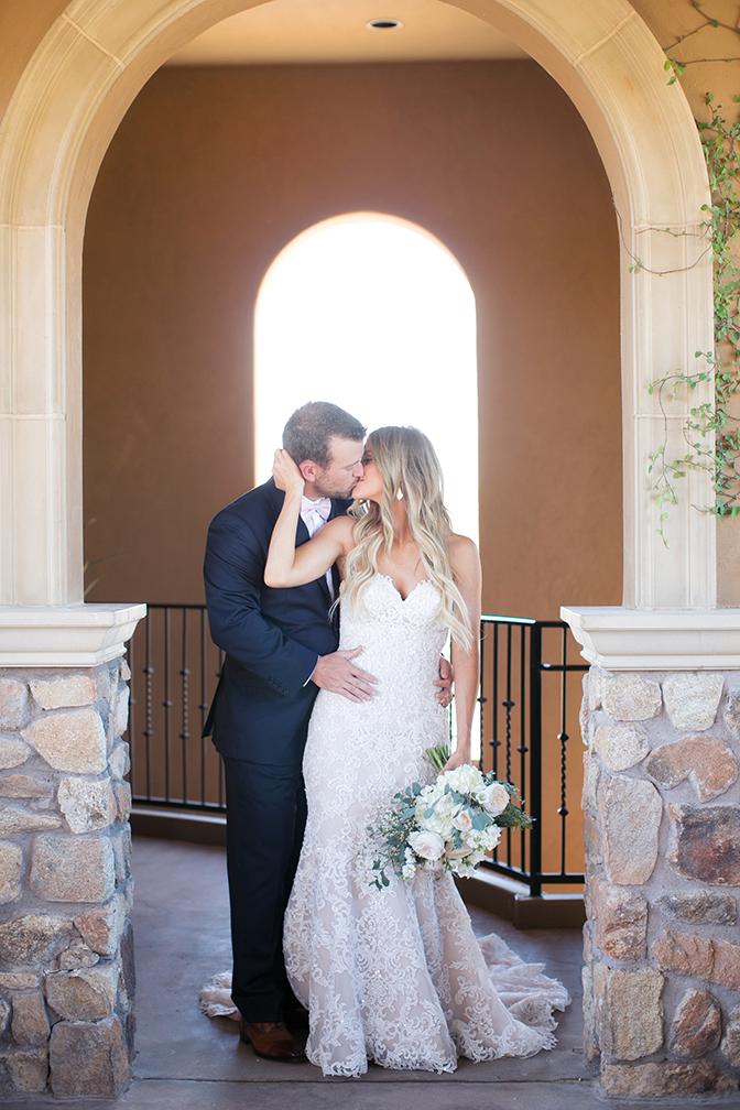Romantic kiss between the brie & groom