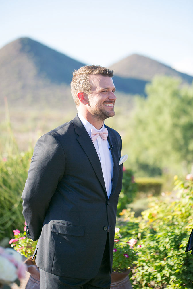 Smiling grooms awaits his bride