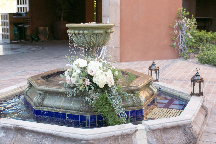 Wedding flowers decorate the fountain at Blackstone Country Club
