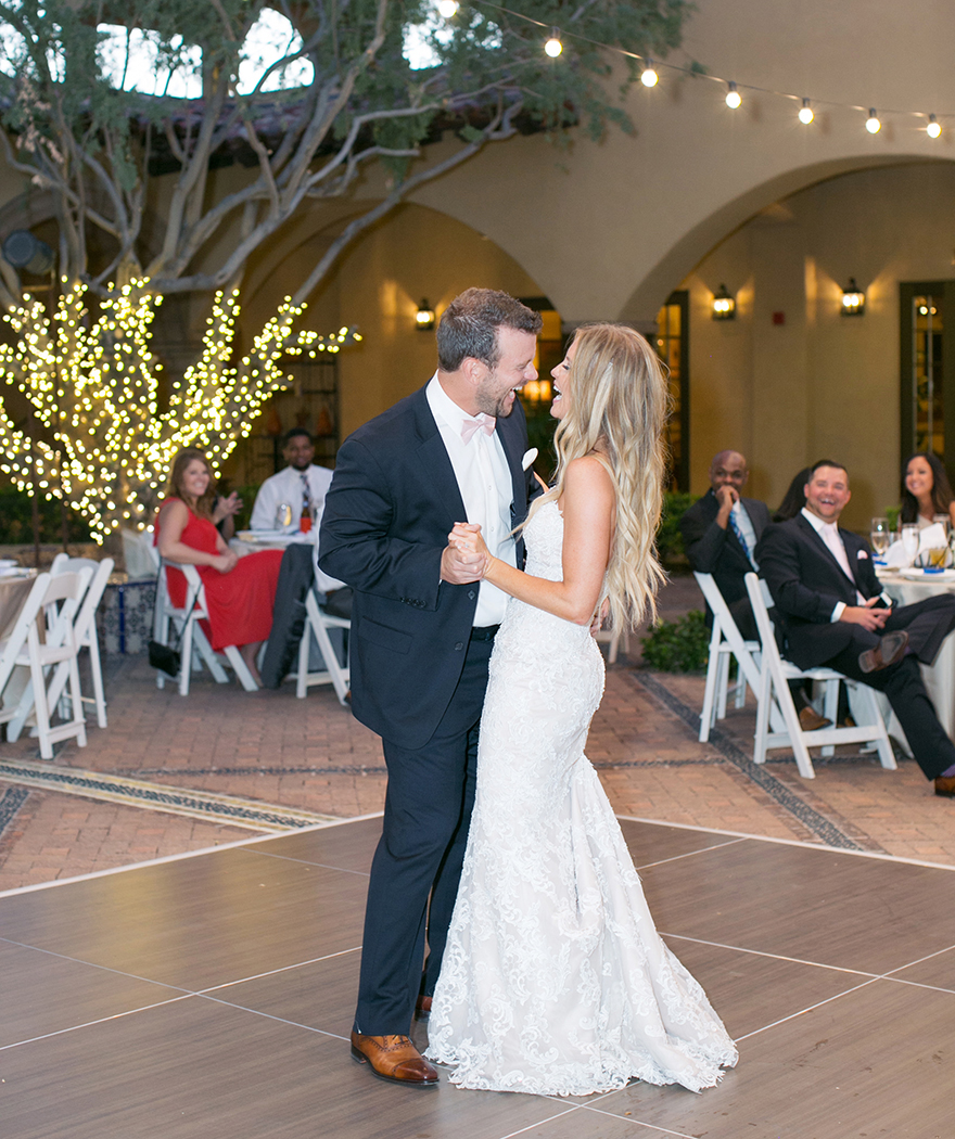 Bride & groom laugh during their first dance