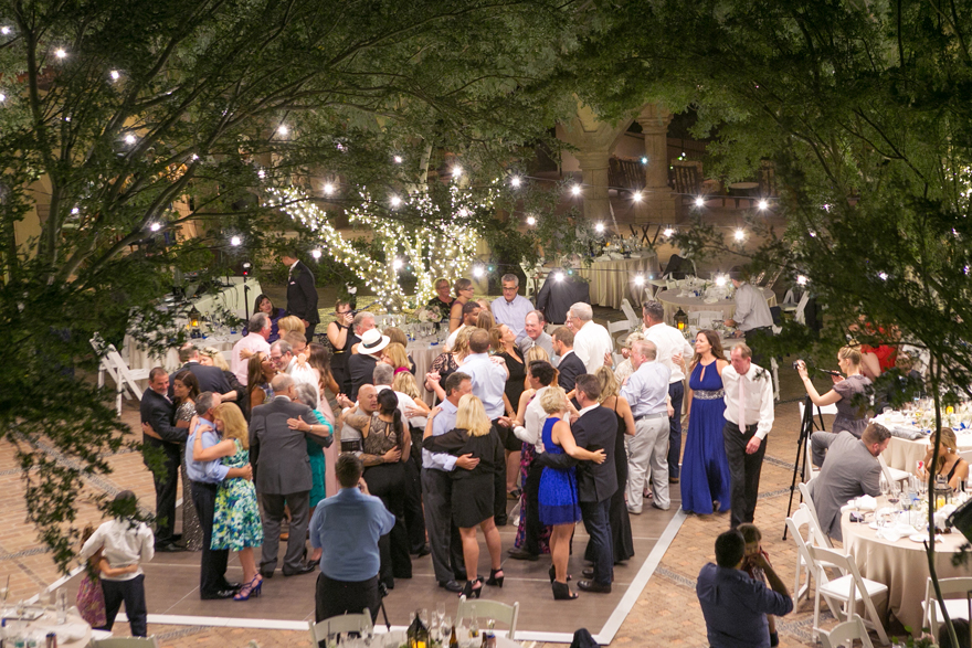 Crowded dance floor at an outdoor wedding reception