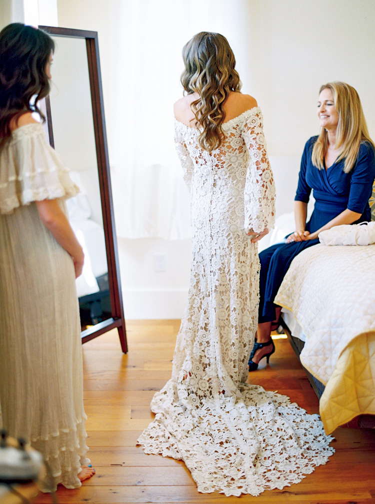 bride in long sleeved, off-the-shoulder bohemian lace wedding dress