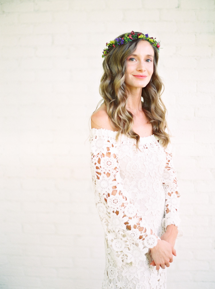 bride in a long-sleeved off-the-shoulder lace bohemian wedding dress with delicate flower crown