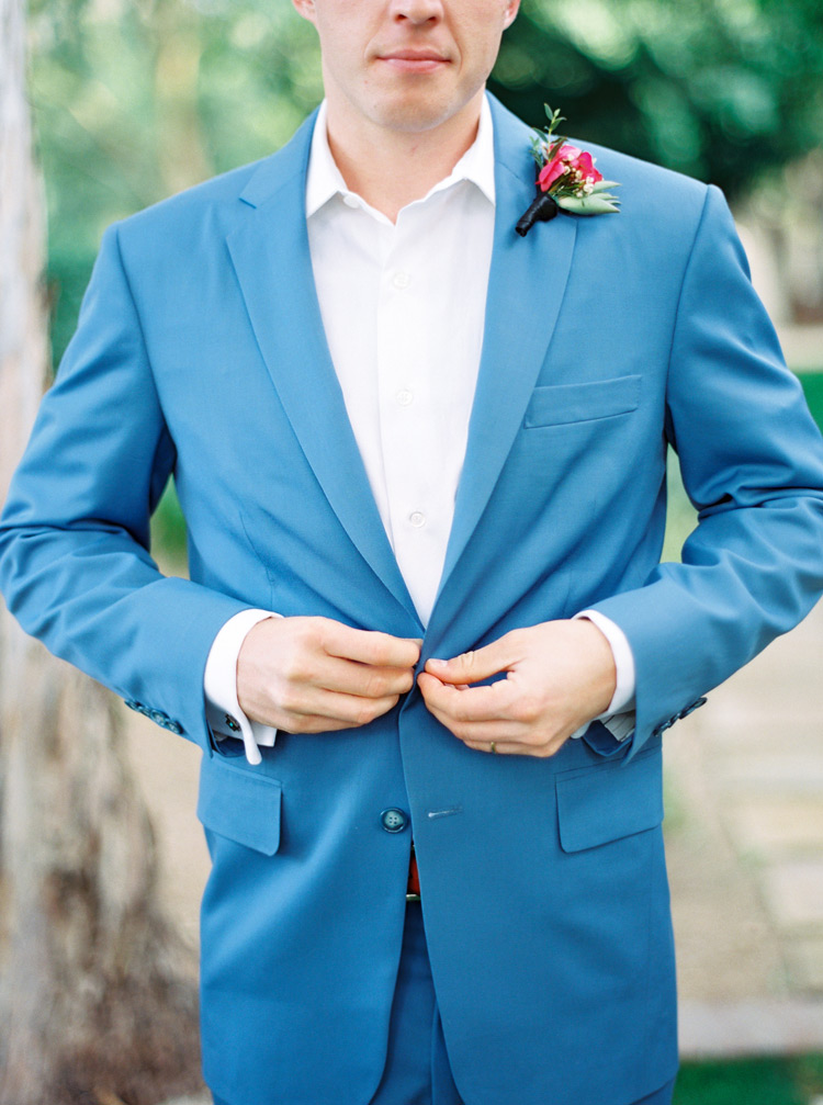 groom in a robins egg blue suit