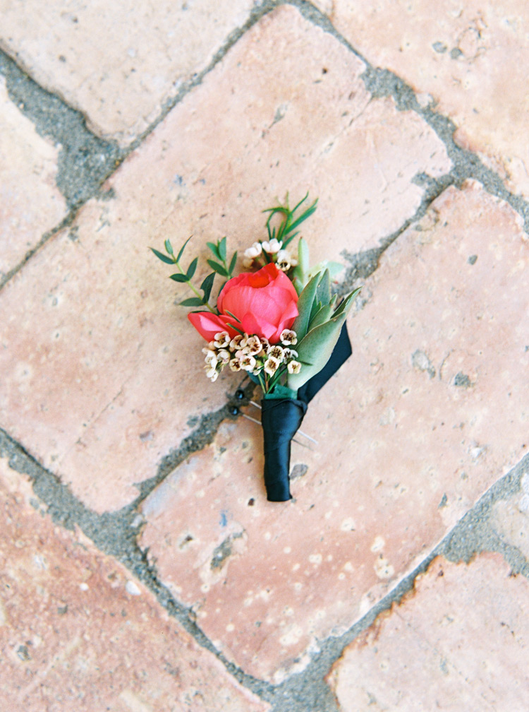 coral pink boutonniere