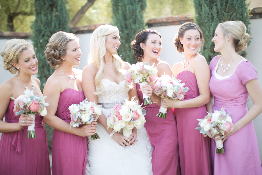 Deep fuchsia bridesmaids laugh sweetly with maid of honor and bride.