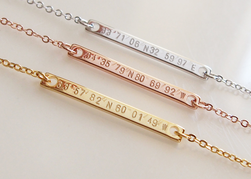 Personalized coordinate silver, rose gold and gold necklaces.