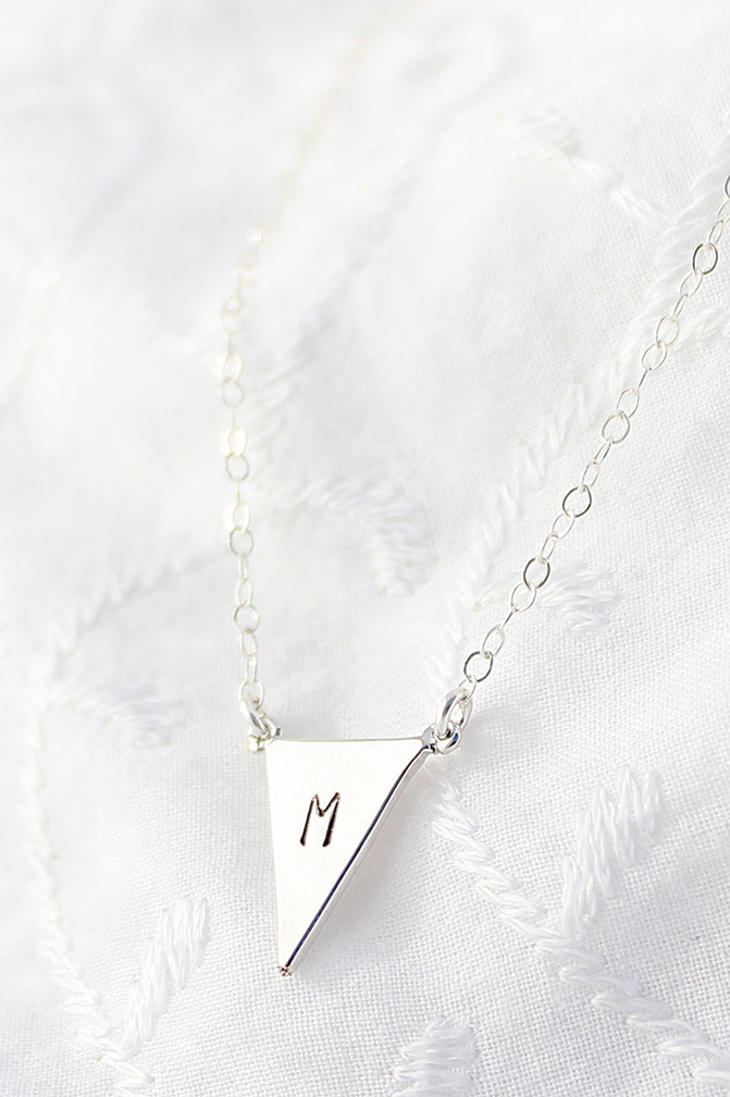 Long- chain custom initial silver necklace.
