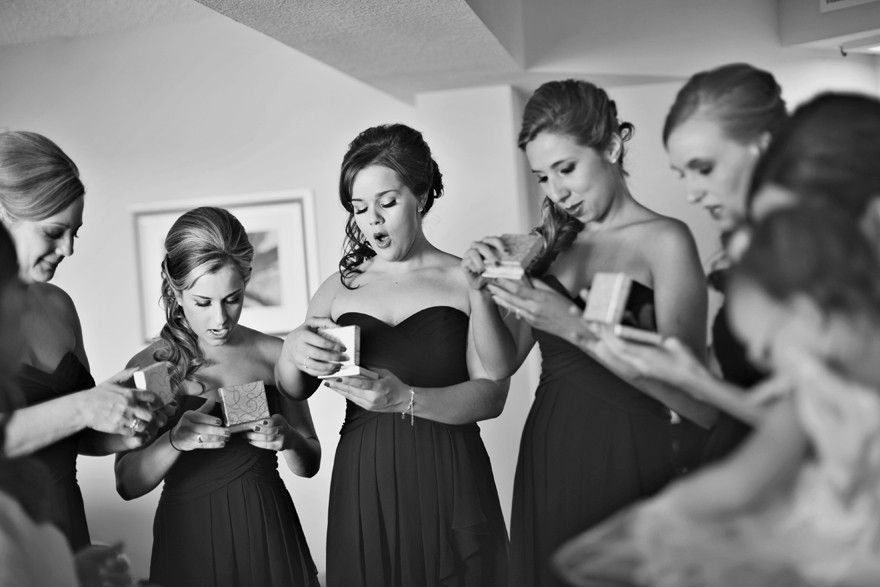 Bridesmaids reaction from opening their personal jewelry piece from bride.