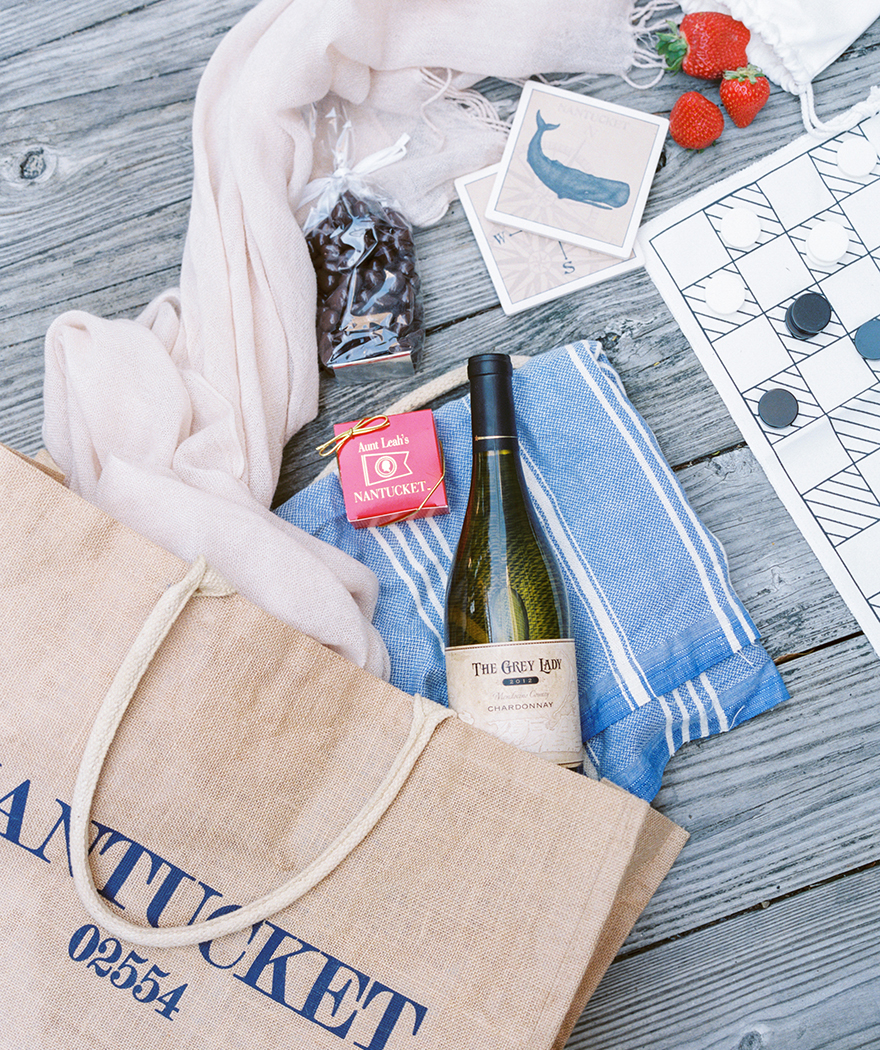 Baby blue gift bag set for bridesmaids. Travel a seas set with wine, chocolate and games.