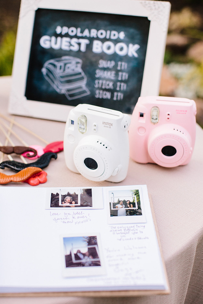 Polaroid book with cameras for guest book memories.