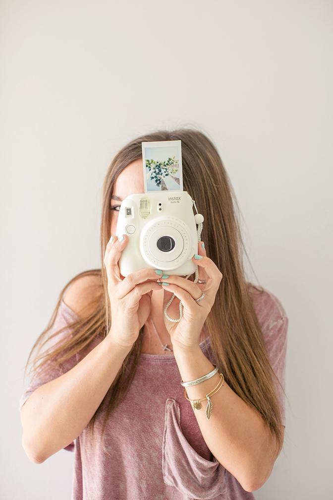 Chic snapping fun polaroid photos.