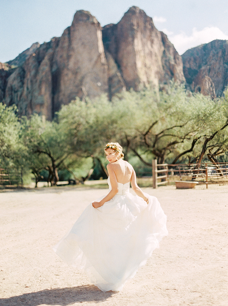 Desert wedding inspiration with mountain backdrop, bride in casual wedding dress and flower crown