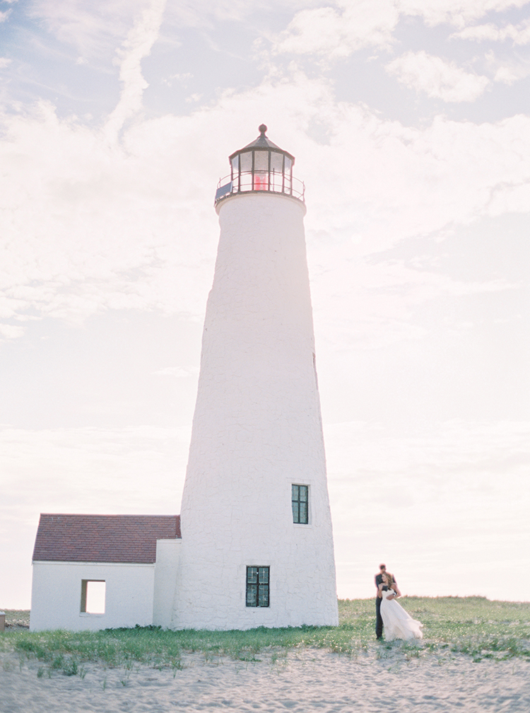 Gorgeous dramatic wedding photography at light house. Great Point Lighthouse in Nantucket, MA.