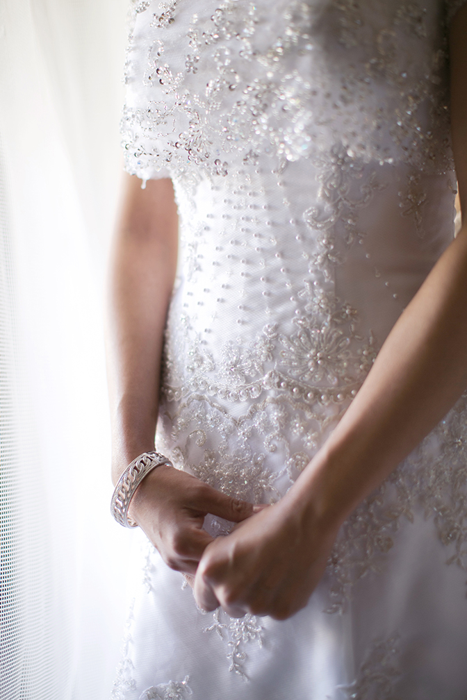 Gorgeous delicate wedding dress with beading and pearl details