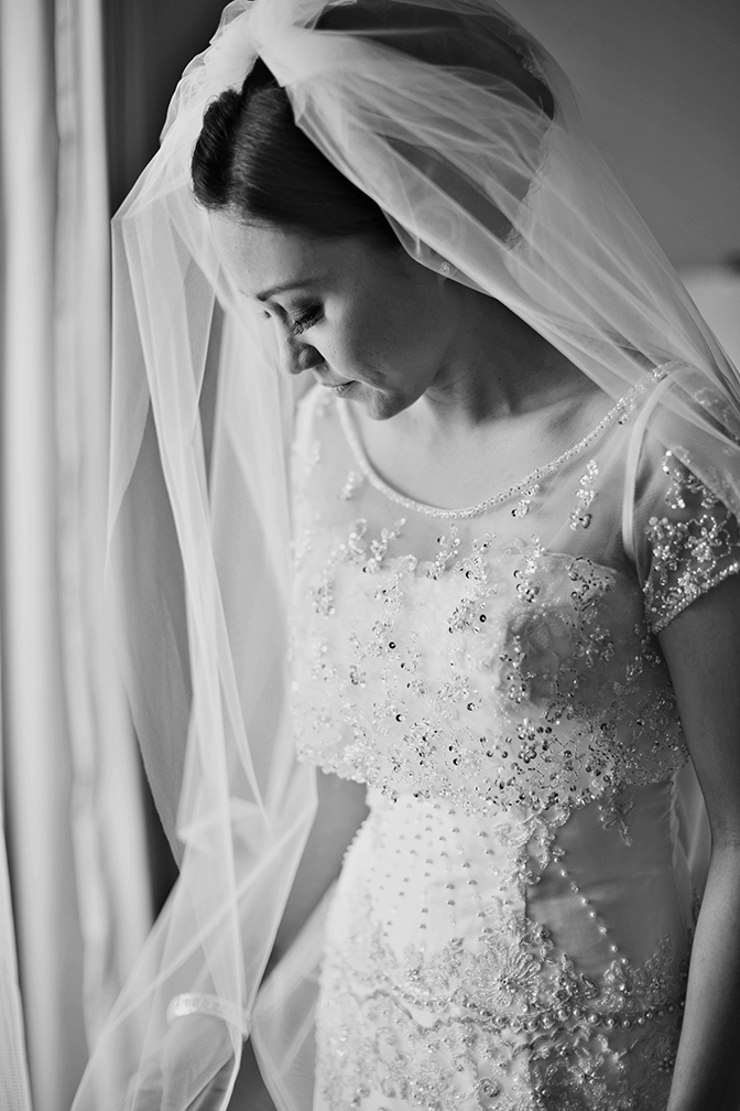 Gorgeous delicate wedding dress with beading and pearl details. Wedding dress photography.