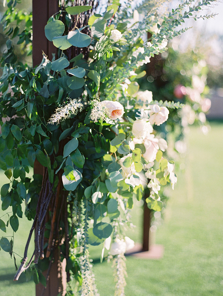 lush pink & cream flowers adorn the chuppah