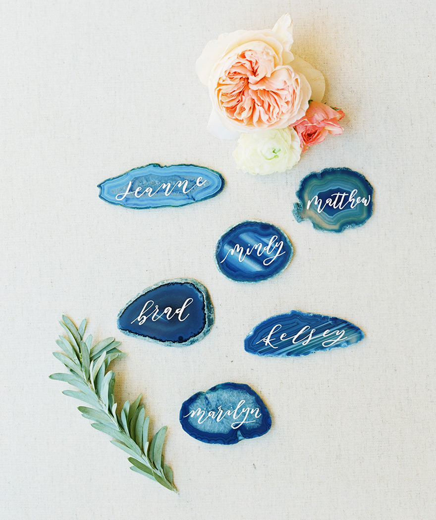 agate slices with calligraphy as escort cards