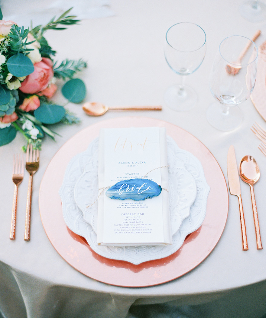 reception tablescape with copper accents and agate slices as name cards