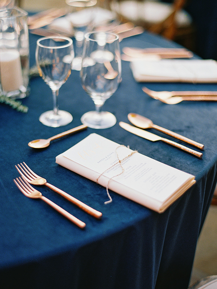 outdoor wedding reception with wood and copper accents