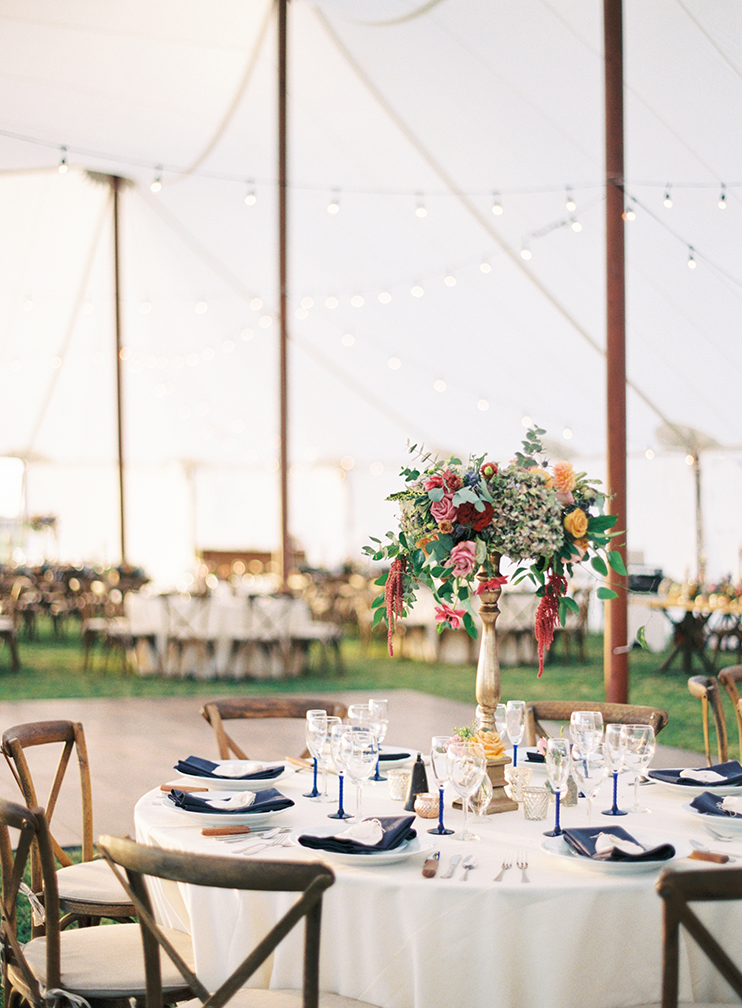 colorful flowers and blue accents in a reception tent