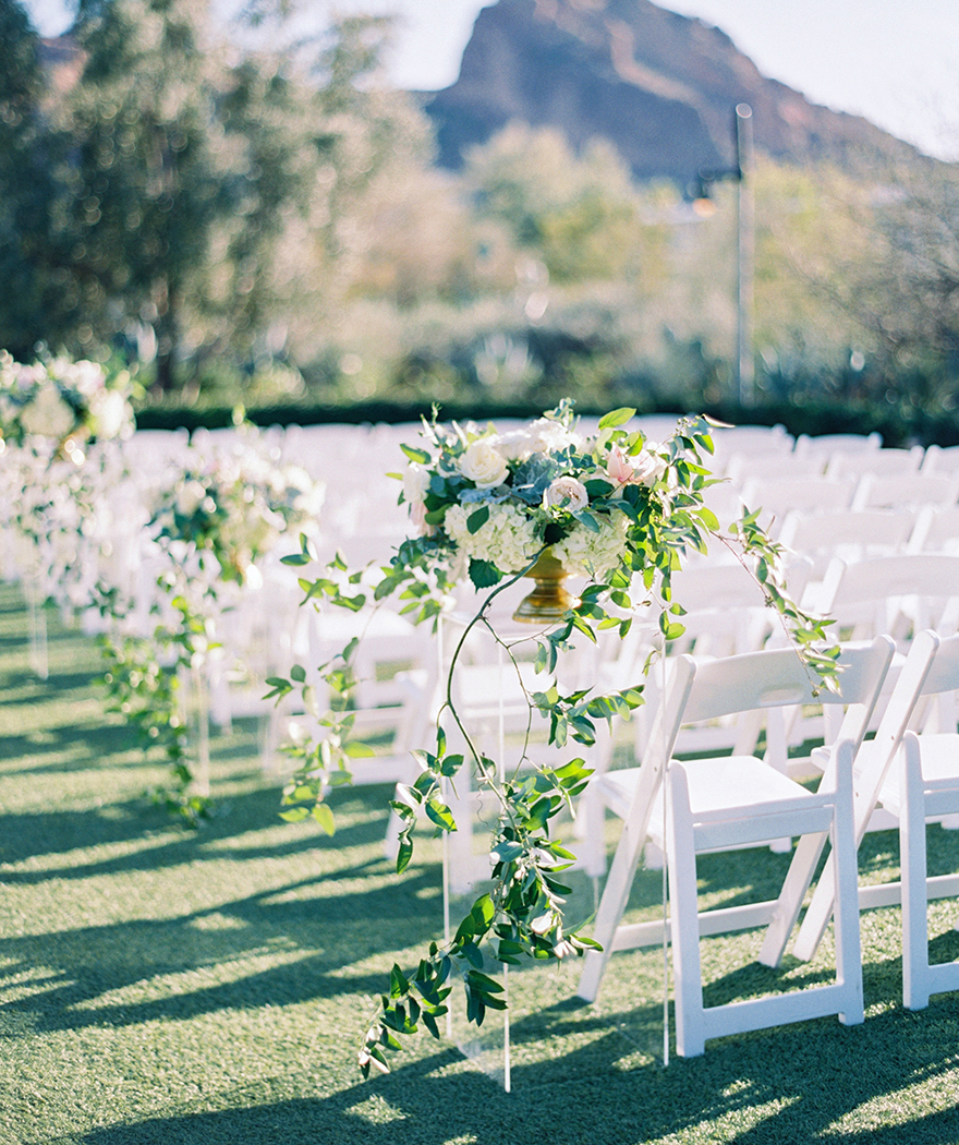 bowls of flowers & trailing greenery in a wedding ceremony