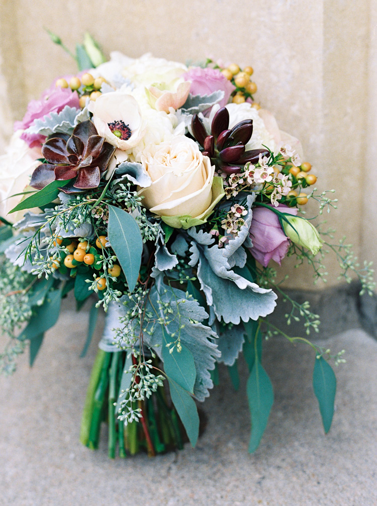 Brides bouquet. Beautiful floral arrangement with deep reds and other colors.