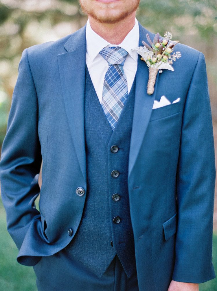 Modern blue suit with vest and beautiful vintage boutonniere. Groom suit ideas & inspiration.