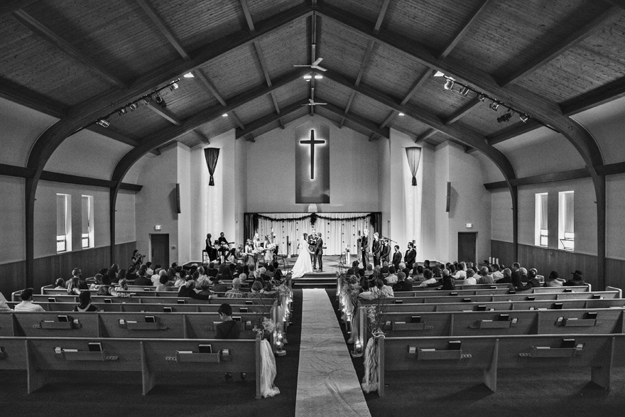 Indoor church wedding in Denver, Colorado. Wedding venue ideas and inspiration. Black & White photo.