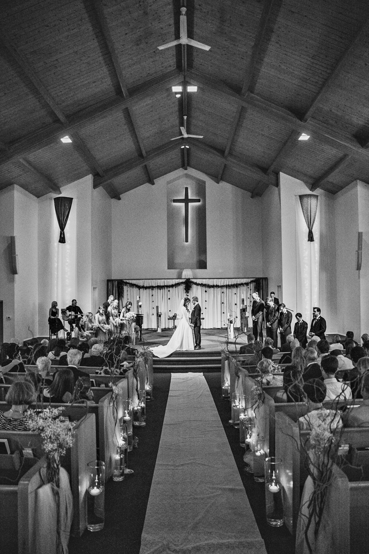 Candle lit indoor church wedding in Denver, Colorado. Wedding venue ideas and inspiration.