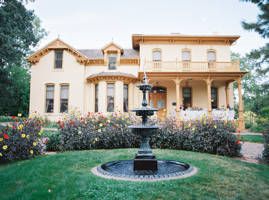 Gorgeous estate in Denver, Colorado. Victorian mansion with water fountain in courtyard.