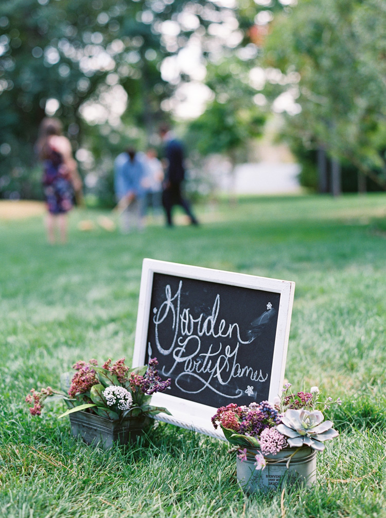 Beautiful purple and pink flower arrangement with chalkboard sign. Wedding decor ideas & inspiration